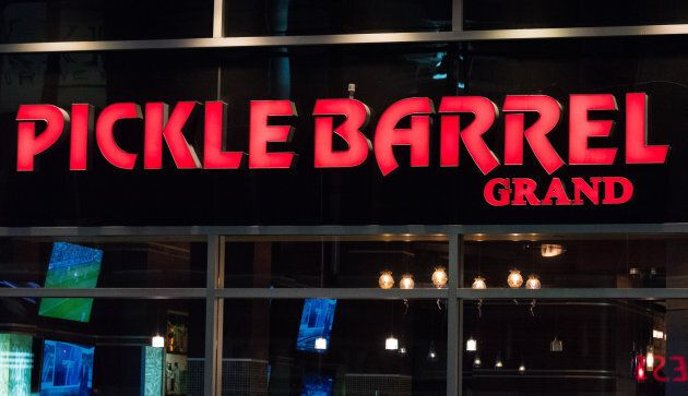 The glowing red signage of the Pickle Barrel Grand restaurant is shown in