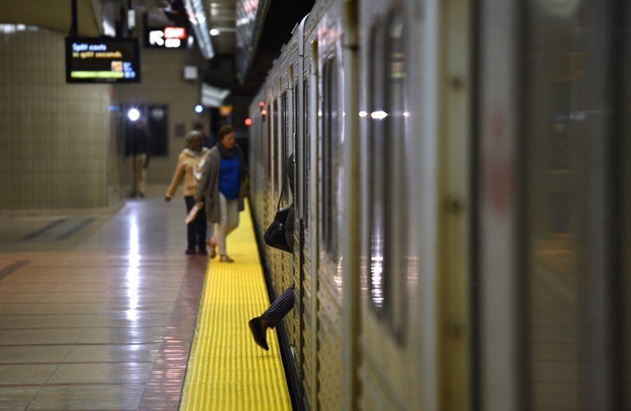 Commuters board the TTC subway at the Don Mills stop on the Sheppard line in Toronto on Oct. 3,