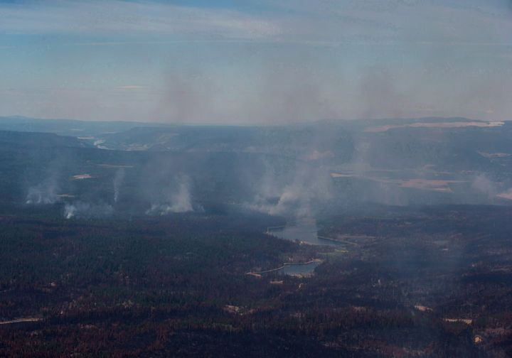 Smoke from wildfires fills the air and burned trees are seen in this aerial view from a Canadian Forces Chinook helicopter near Williams Lake, B.C., on July 31, 2017.