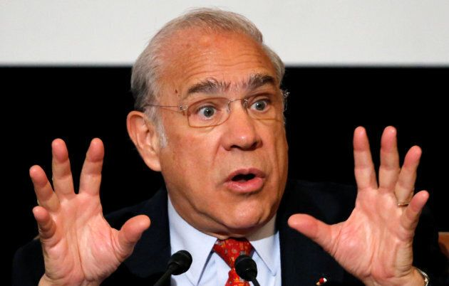 OECD Secretary General Jose Angel Gurria attends a news conference at the Japan National Press Club in...