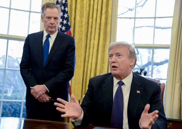 U.S. President Donald Trump speaks after signing Section 201 actions next to Bob Lighthizer, U.S. trade...