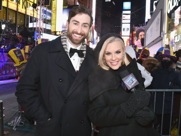 HQ Trivia host Scott Rogowsky and Jenny McCarthy pose at Dick Clark's New Year's Rockin' Eve with Ryan Seacrest 2018 on Dec. 31, 2017 in New York City.