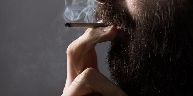 A man is seen smoking a