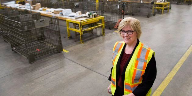 Public Services Minister Carla Qualtrough walks through the mail room at the Canada Post Gateway location...