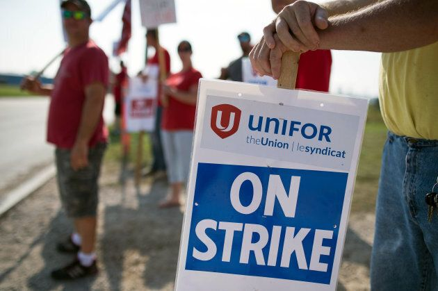 Employees and Unifor members hold 'On Strike' signs outside the General Motors Co. plant in Ingersoll,...