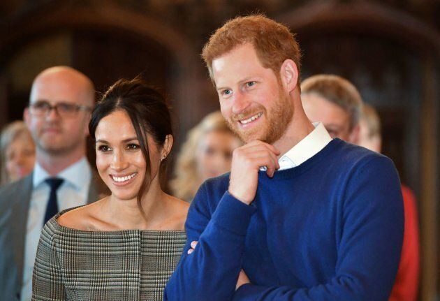Prince Harry and Meghan Markle watch a performance during a visit to Cardiff Castle on Jan. 18,