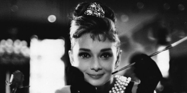 1961: Audrey Hepburn (1929 - 1993) wields a cigarette holder in her role as the charming gold-digger Holly Golightly in 'Breakfast at Tiffany's', directed by Blake Edwards. (Photo via John Kobal Foundation/Getty Images)