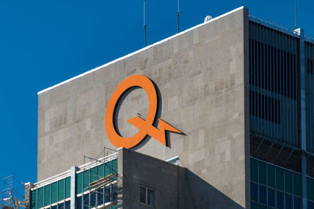 Hydro-Quebec's orange logo on top of building in downtown