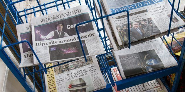 Newspapers for sale at a convenience store in Kingston, Ont., on May 25, 2016. All signs point to print...