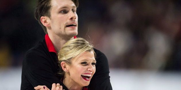 Kirsten Moore-Towers, front, and Michael Marinaro react after performing their short program during the...