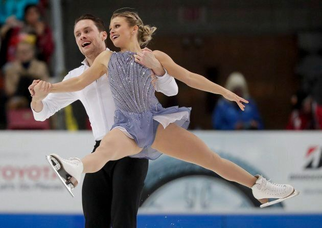 Kirsten Moore-Towers, right, and Michael Marinaro perform during the pairs free skate at Skate America...