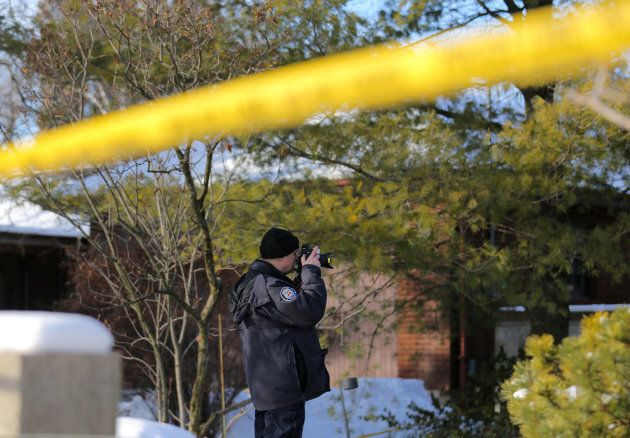 A police forensics photographer works outside the home of billionaire founder of Canadian pharmaceutical...