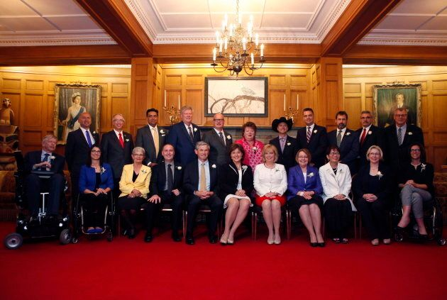 B.C. Premier Christy Clark, centre, and her Liberal cabinet after being sworn in in Victoria, B.C. on...