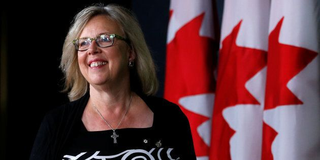 Green Party leader Elizabeth May arrives at a news conference in Ottawa on Aug. 22,