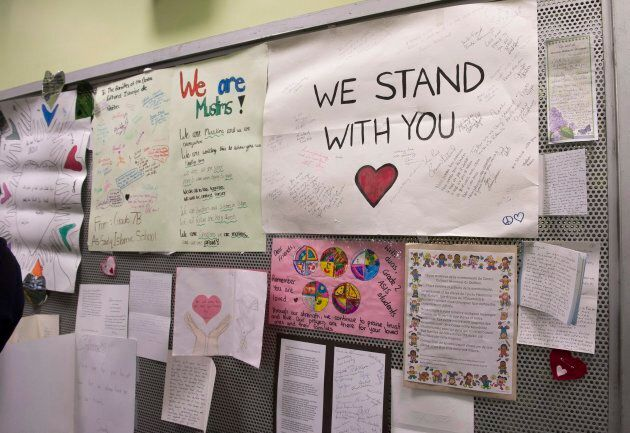 Messages of sympathy are on display during a gathering at the Centre Islamique de Quebec, marking the...