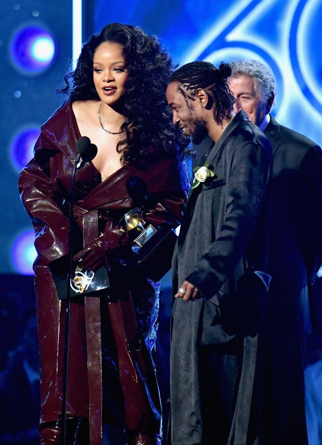 Rihanna and Kendrick Lamar accept the award for Best Rap/Sung Performance onstage.