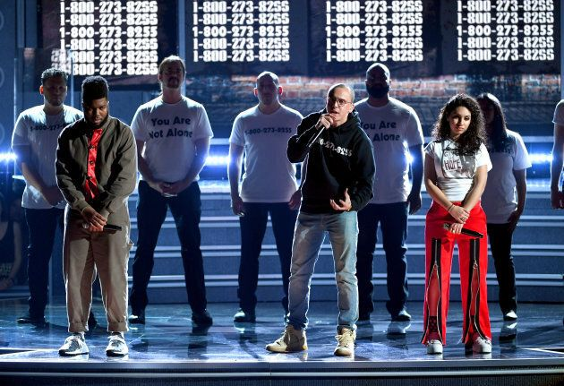 Artists Khalid (left), Logic (middle), and Alessia Cara (right), perform during the Grammy Awards.