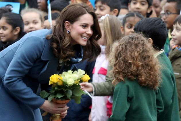 The duchess talks to children as she visits Roe Green Junior School on Jan. 23.