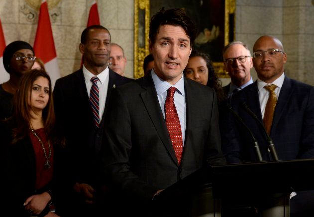 Prime Minister Justin Trudeau speaks with media during an availability in the foyer with his caucus on...