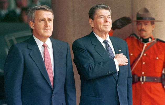 Former U.S. President Ronald Reagan stands with former Prime Minister Brian Mulroney in Toronto on June...
