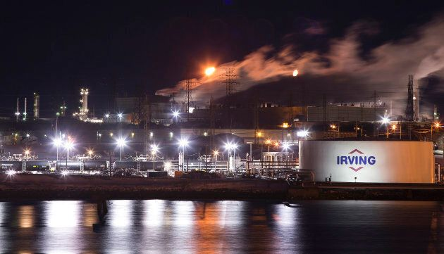 An Irving Oil storage facility and crude rail cars are photographed at the edge of Courtenay Bay on in...