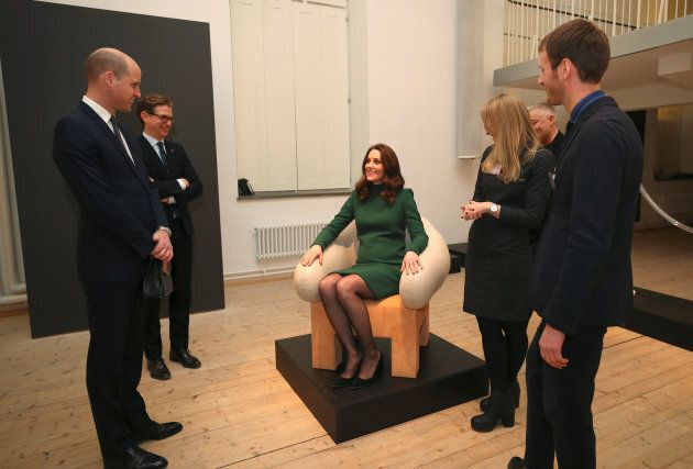 The Duchess of Cambridge tries out a chair as she visits the ArkDes museum during her royal visit to Sweden.