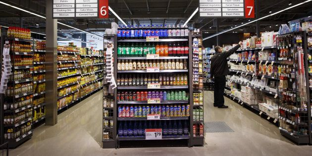 A customer shops inside a Metro Inc. grocery store in Toronto, Mon. Oct. 2,