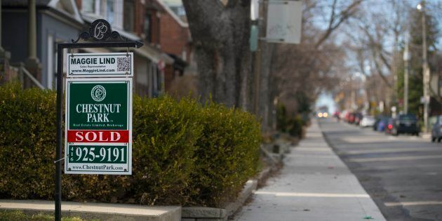 A for sale sign for a house in Toronto's St. Clair and Arlington neighbourhood. New polling data from...