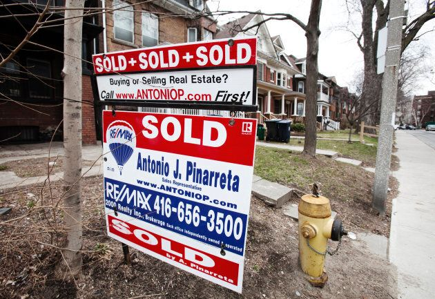 A sign indicating a house has been sold on the real estate market is seen in Toronto, April 9,