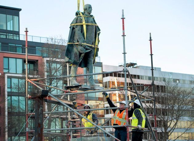 Contractors remove the statue of Edward Cornwallis in a city park in Halifax on Jan. 31,
