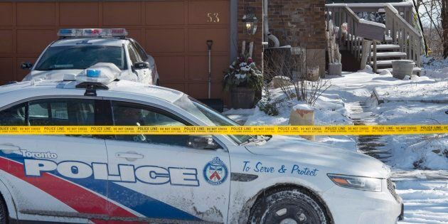 Police stand guard at a house on Mallory Crescent in Toronto on Jan. 30, 2018. Police are investigating...