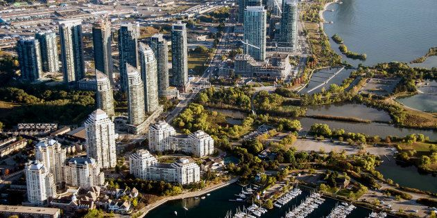 Condominiums stand along the shore of Lake Ontario in this aerial photograph taken above Toronto, Mon....