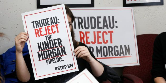 A protester takes part in a sit-in against the proposed expansion of Kinder Morgan's Trans Mountain pipeline...
