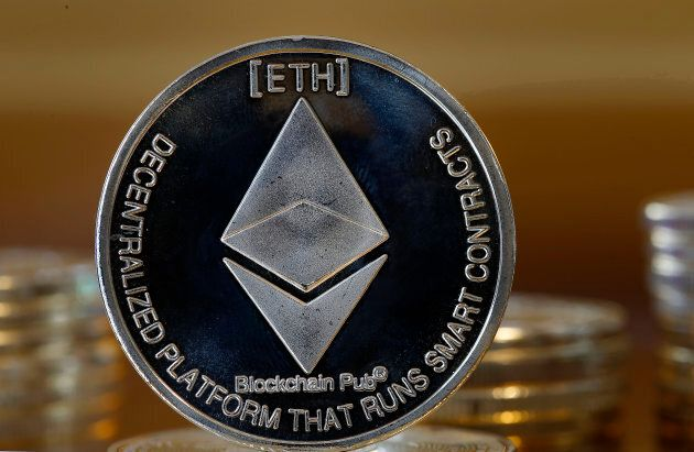 In this photo illustration, a visual representation of the digital Cryptocurrency Ethereum is displayed...