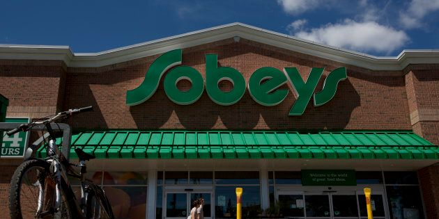 Pedestrians pass in front of a Sobeys Inc. grocery store in Toronto on July 24,