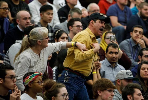 An angry spectator confronts Prime Minister Justin Trudeau during a town hall meeting in Edmonton on