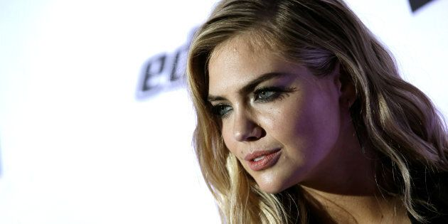 Model Kate Upton poses for photographers at a launch event for the 2017 Sports Illustrated Swimsuit Issue...