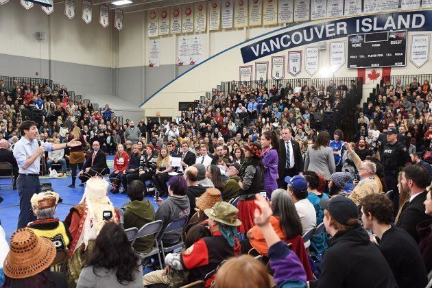 Prime Minister Justin Trudeau, left, argues with a protester at a public town hall in Nanaimo, B.C., on Feb. 2, 2018.