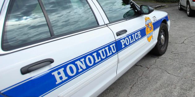 Police cars are seen parked in front of Roosevelt High School after a shooting incident in Hawaii Jan....