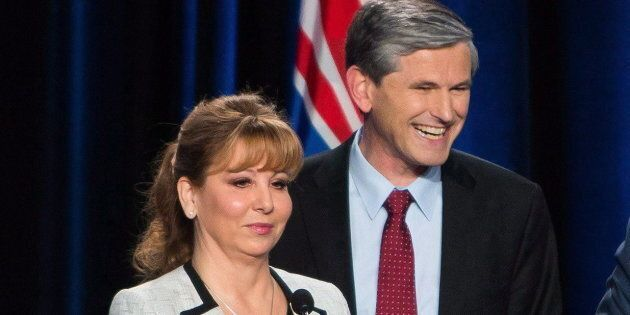 Dianne Watts and Andrew Wilkinson take a break during a leadership debate in Vancouver on Jan. 23,