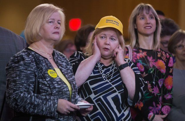 A supporter of candidate Dianne Watts covers her ears as Chinese lion dancers perform as B.C. Liberal...