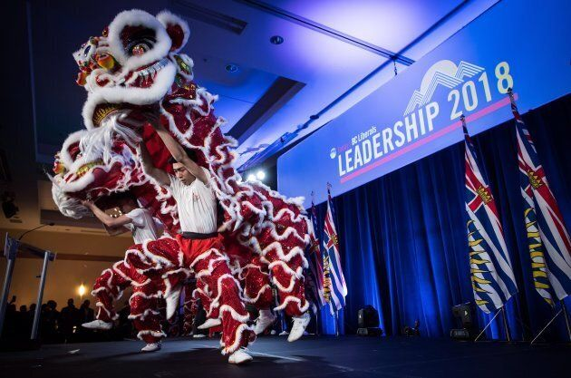 Chinese lion dancers perform as B.C. Liberal Party members and supporters await the results of a leadership...