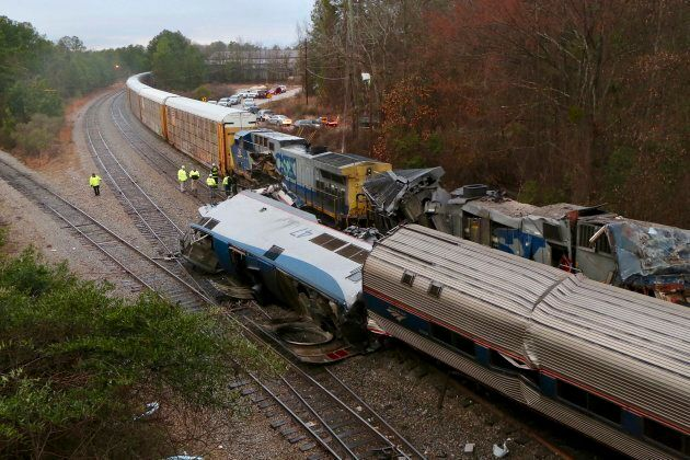 Authorities investigate the scene of a fatal Amtrak train crash in Cayce, S.C. on Feb. 4,