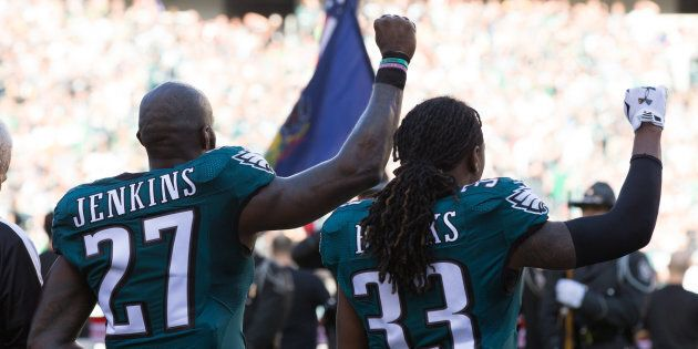 Philadelphia Eagles strong safety Malcolm Jenkins and defensive back Ron Brooks hold up fists during...