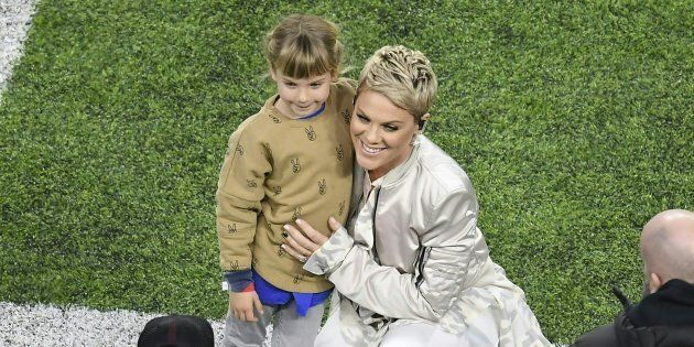 Recording artist Pink poses with her daughter before singing the US National Anthem for the start of...