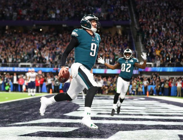 Philadelphia Eagles quarterback Nick Foles (9) catches a touchdown pass against the New England Patriots...