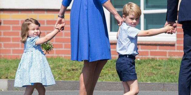 Prince George and Princess Charlotte arrive at Berlin military airport during an official visit to Poland and Germany on July 19, 2017.