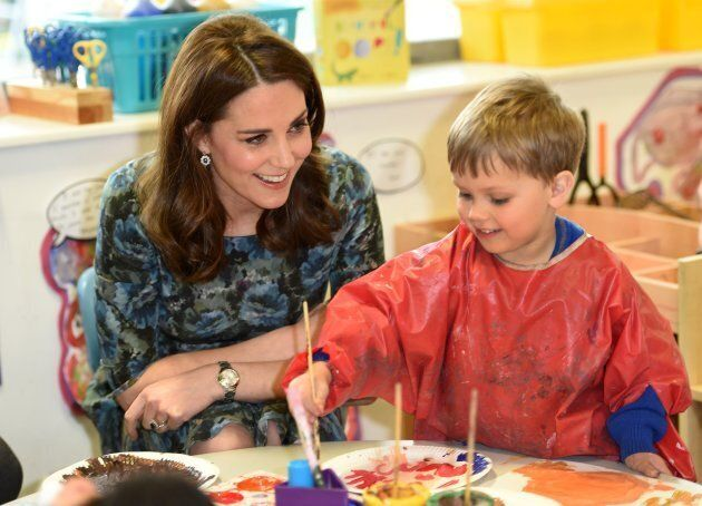 Duchess of Cambridge interacts with children during her visit to the Reach Academy Feltham on Jan.