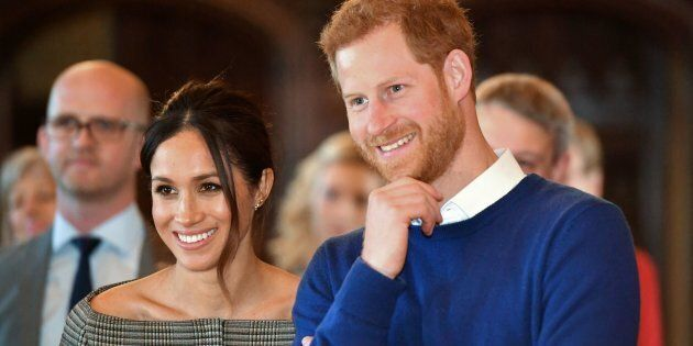 Prince Harry and Meghan Markle watch a performace during a visit to Cardiff Castle on Jan. 18.