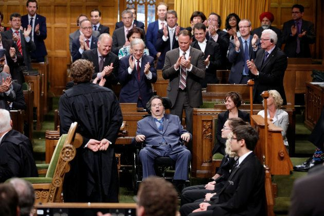Liberal MP Mauril Belanger receives a standing ovation while voting on his private member's bill to change...